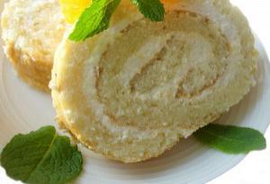 Pineapple sponge cake roll with whipped cream ( Greek whipped cream kormos )