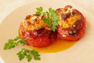 Stuffed tomatoes topped with bechamel sauce